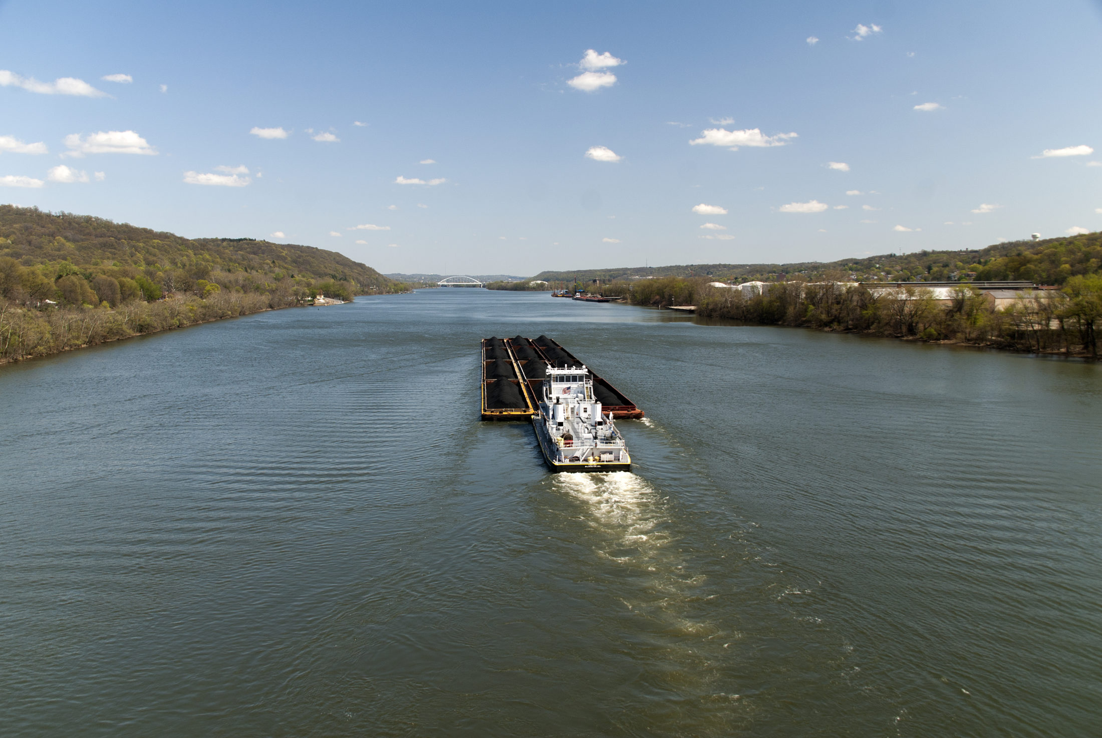 A coal freighter moves upriver