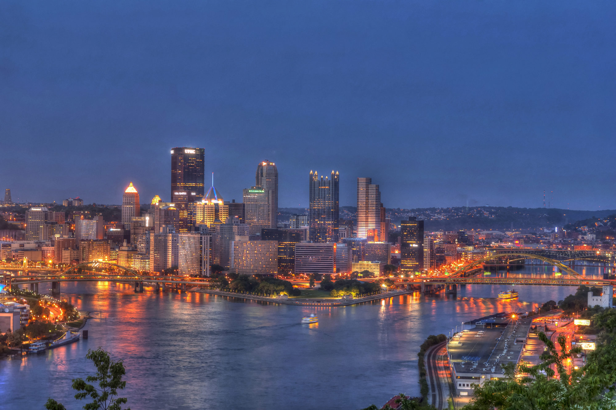 Nighttime shot of Pittsburgh with the Point in the foreground