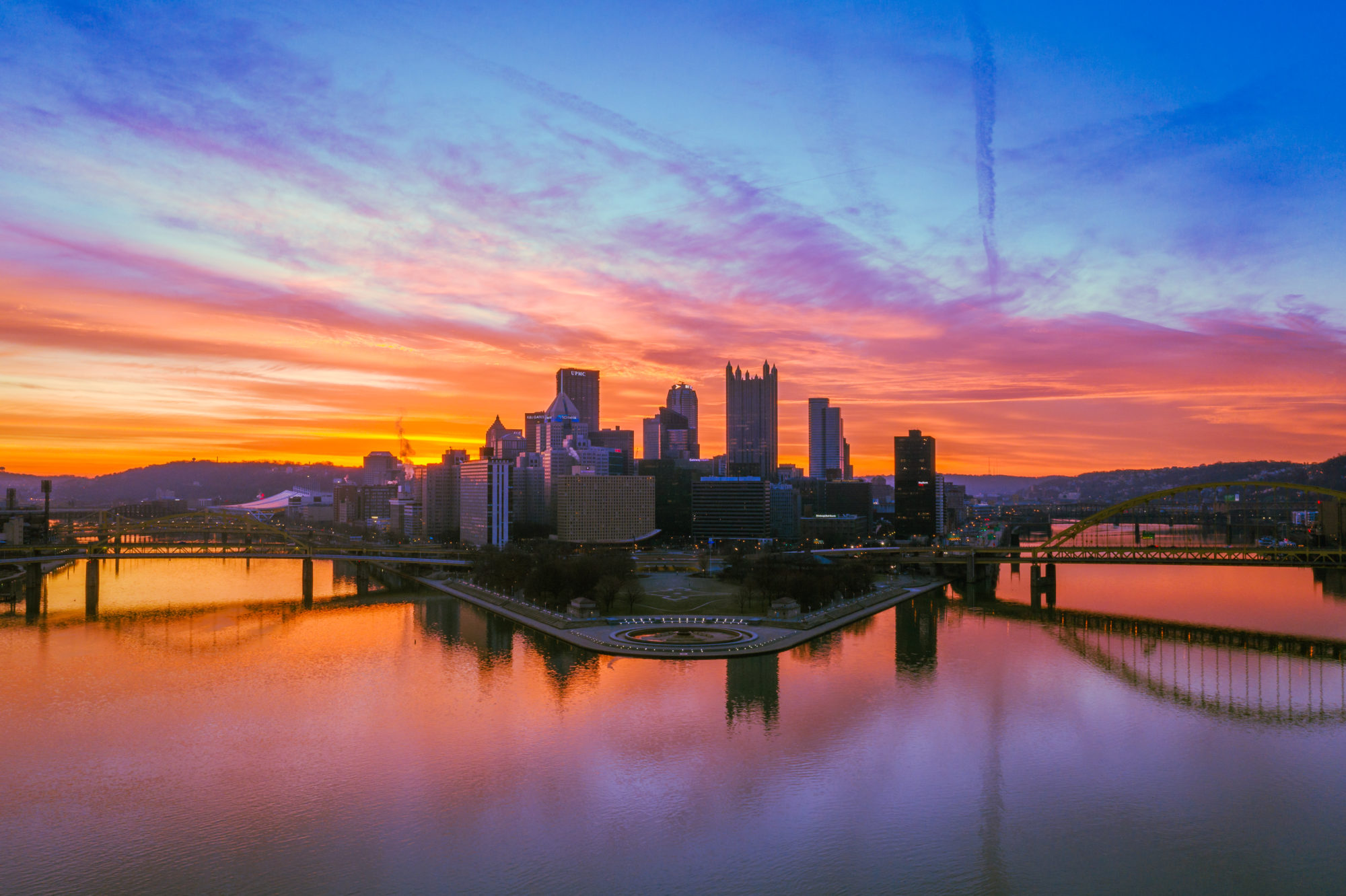 Scenic sunset shot of downtown Pittsburgh with The Point in the foreground